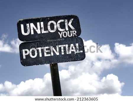 Unlock your Potential sign with clouds and sky background  - stock photo
