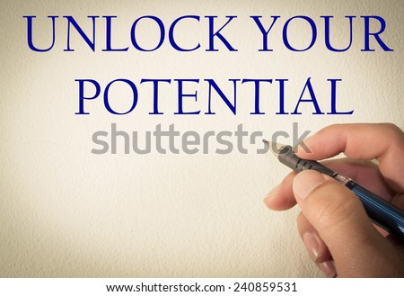 unlock your potential text write on wall  - stock photo
