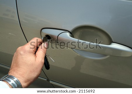 Unlocking / locking a car - stock photo