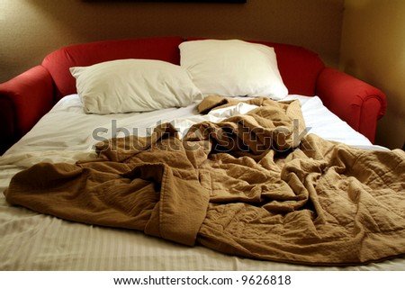 Unmade sofa bed - stock photo