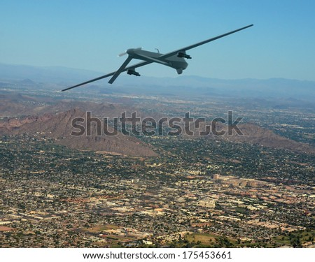 Unmanned military drone on patrol air to air - stock photo