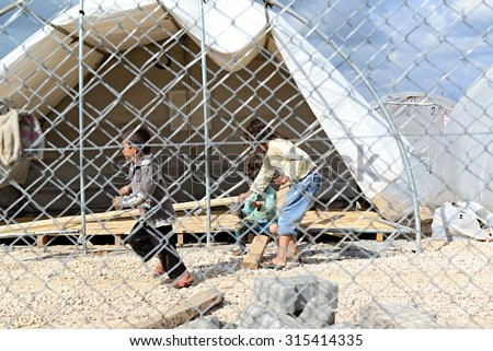 Unnamed  syrian (kurdish) people in refugee camp in Suruc. These people are refugees from Kobane and escaped because of Islamic state attack. March 30, 2015; Suruc, Turkey