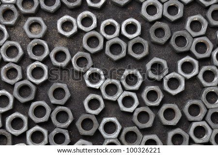 Unordered set of chrome nuts - stock photo