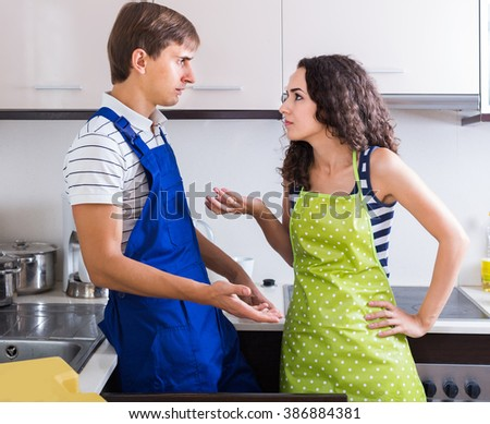 Unprofessional american plumber asking furious young woman for bribes indoors - stock photo