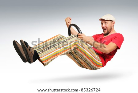 Unreal bearded man car driver in striped trousers and sandals, a cap, concept - stock photo