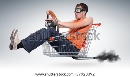 Unreal crazy driver in a shopping-cart with wheel - stock photo