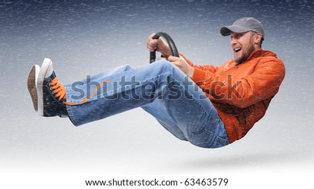 Unreal driver goes with a wheel to a snowstorm concept - stock photo