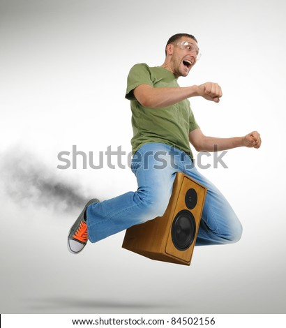 Unreal flying man sitting on a speaker with smoke, motorcycle stylize concept - stock photo