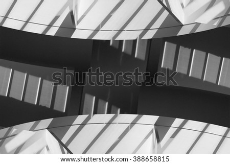 Unreal fragment of rotunda / round room / hall with shadows from modular structures. Refined double exposure photo of abstract contemporary architecture in soft shades of black and white palette. - stock photo