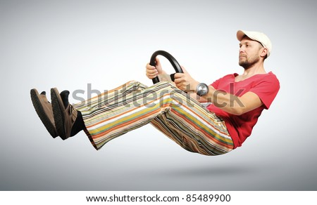 Unreal funny car driver in the humorous huge wristwatch, a cap, auto concept - stock photo