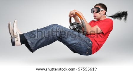 Unreal funny driver in goggles - stock photo