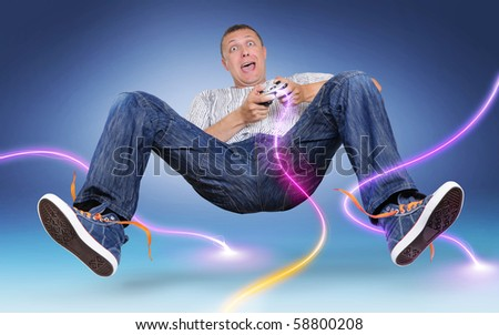 Unreal gamer with gamepad, color electric discharge around - stock photo