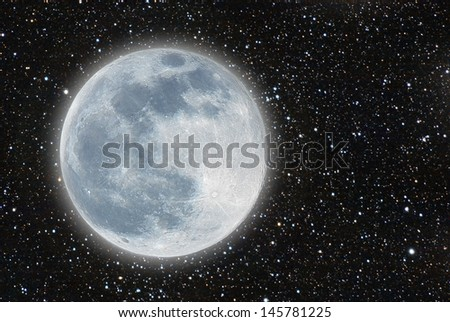 unreal moon over a great starfield - stock photo