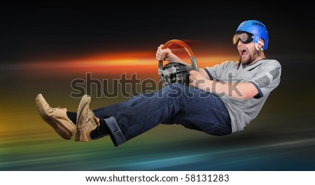 Unreal night driver in goggles with wheel - stock photo