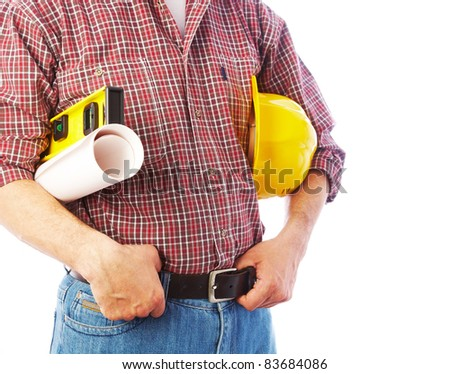 unrecognizable builder with the tools and a helmet under his arm - stock photo