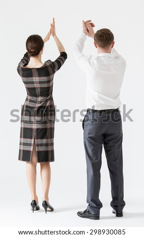 Unrecognizable business people applauding, white background