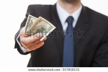 Unrecognizable businessman giving one hundred dollars, closeup shot