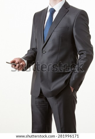Unrecognizable businessman holding a cellphone, white background