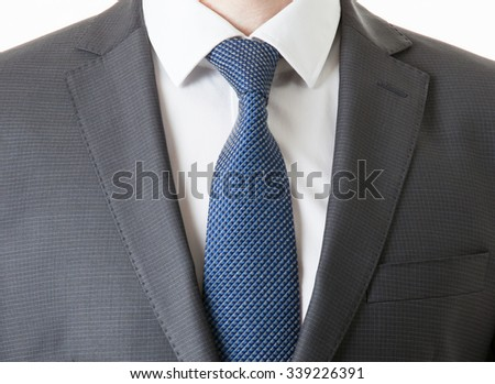 Unrecognizable businessman in a classical suit, white background