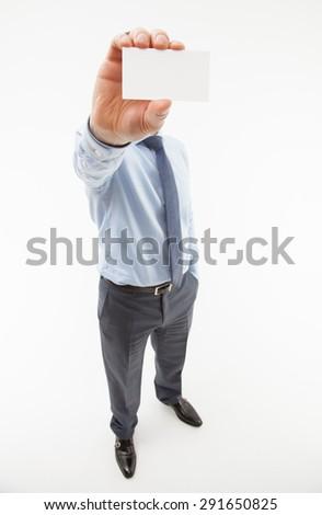 Unrecognizable businessman showing business card - closeup shot - stock photo