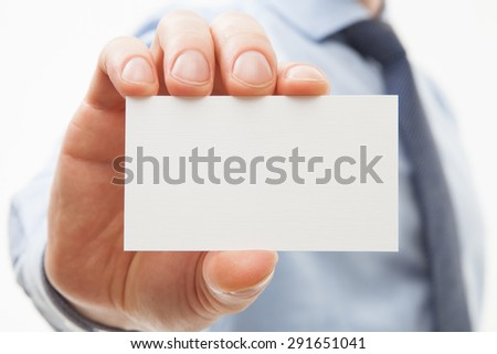 Unrecognizable businessman showing business card - closeup shot - stock photo