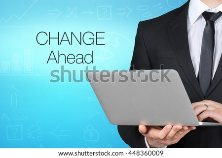 Unrecognizable businessman with laptop standing near text - change ahead - stock photo