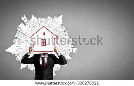 Unrecognizable businesswman holding paper covering her face