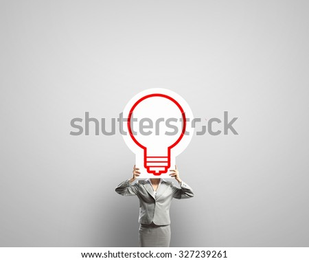 Unrecognizable businesswoman holding paper covering her face - stock photo