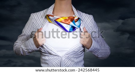 Unrecognizable businesswoman opening her shirt like superhero - stock photo