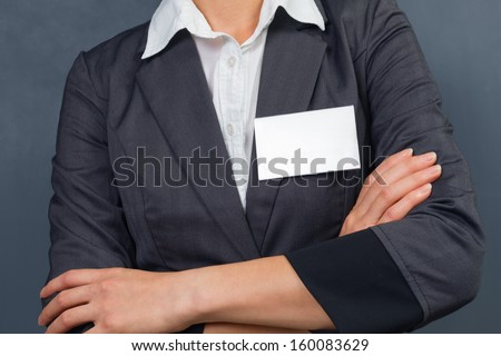 Unrecognizable businesswoman with id card on the chest, copyspace - stock photo
