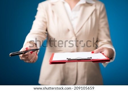 Unrecognizable female manager giving document to sign - stock photo