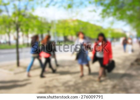 Unrecognizable females walking in the spring park - stock photo