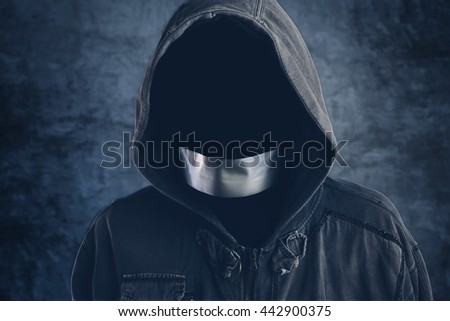 Unrecognizable hooded hooligan with mouth duct taped, spooky faceless criminal person - stock photo