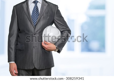 Unrecognizable man holding white helmet - stock photo