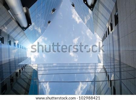 unrecognizable modern skyscraper and sky as the futuristic backdrop - stock photo