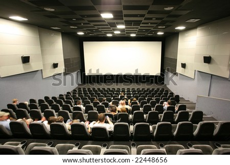 Unrecognizable people in a cinema hall - stock photo