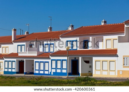Unrecognizable Residential House at Algarve, Portugal. Bright Blue Sky as a Background - stock photo