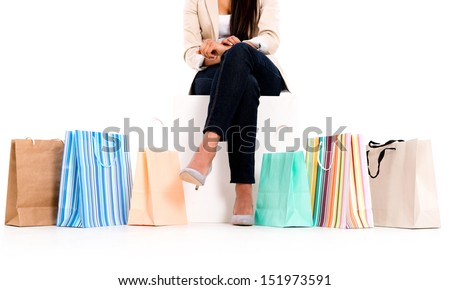 Unrecognizable shopping woman with bags - isolated white background
