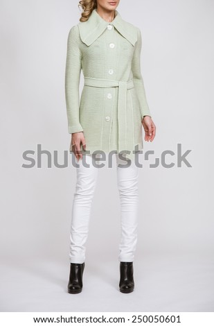 Unrecognizable slender young woman on neutral background - stock photo