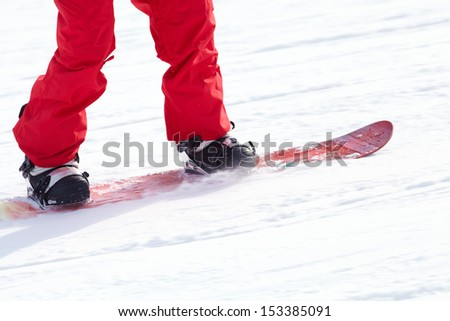 unrecognizable snowboarder on ski resort - stock photo