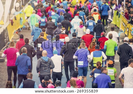 Unrecognizable young runners at the start of a city race - stock photo