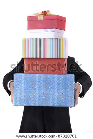 Unrecognized businessman carrying Christmas gifts isolated on white - stock photo