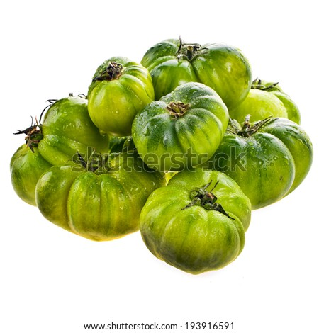 unripe green tomatoes with water drops  lie slide  isolated on white background