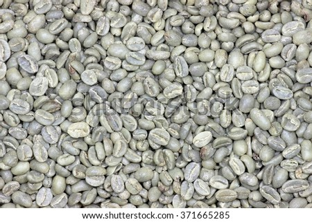 unroasted Ethiopian Sidamo coffee beans for background use - stock photo
