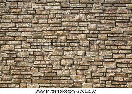 Unshaped stone wall pattern,wall made of rocks - stock photo