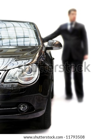 Unsharping businessman around his black car