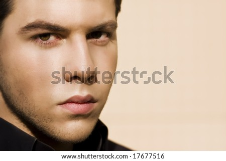 Unshaved handsome man close portrait - stock photo