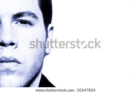 Unshaved handsome man portrait in blue tone. - stock photo