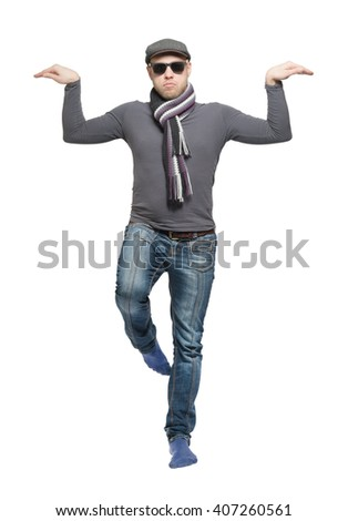 Unshaven bald man wearing a cap, jeans, sunglasses and a scarf dancing a strange dance. Isolated - stock photo