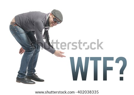 Unshaven bald man wearing a cap, jeans, sunglasses and scarf crouched and points to the inscription WTF. Isolated - stock photo